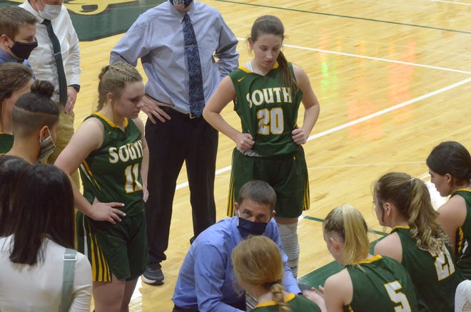 Salina South Girl's Head Basketball Coach Ryan Stuart gives advice during a timeout in the game against Buhler at Salina South on Thursday night.