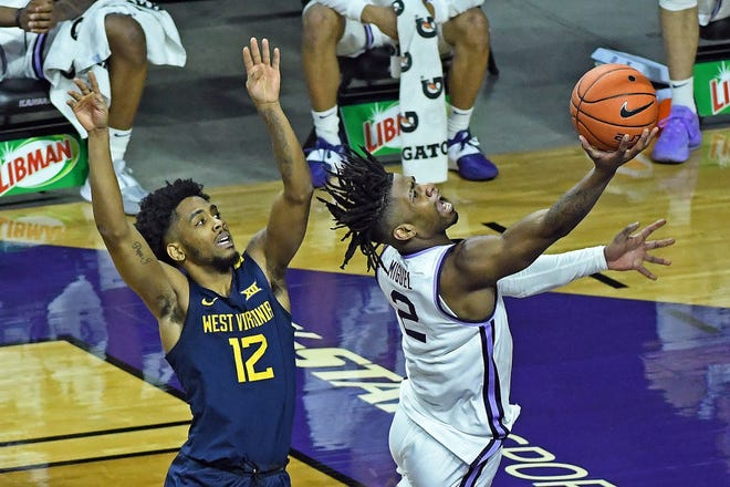 Kansas State freshman Selton Miguel drives past West Virginia's Taz Sherman for a second-half layup during Saturday's game at Bramlage Coliseum.