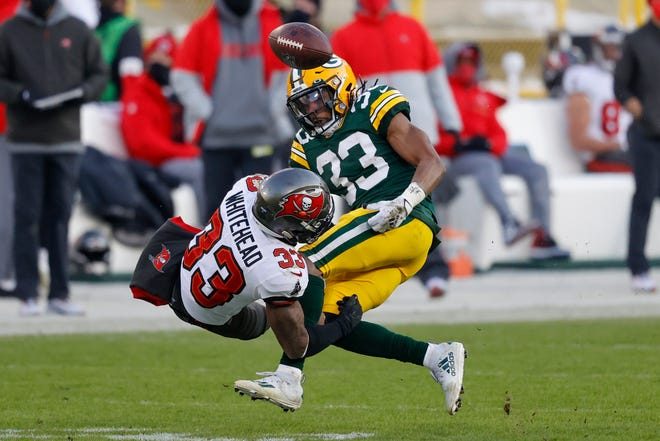 Green Bay's Aaron Jones fumbles after being hit by Tampa Bay's Jordan Whitehead during the second half of the NFC championship game in Green Bay, Wis.