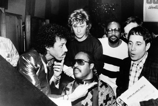 """Historic superstar recording of """"We Are The World"""" by USA for Africa, on Jan. 28, 1985. Clockwise, left to right; Lionel Richie, Daryl Hall, Quincy Jones, Paul Simon and Stevie Wonder. (AP Photo)"""