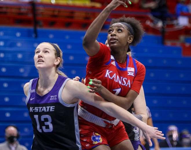 Kansas women's basketball forward Tina Stephens, right, fights for positioning with Kansas State's Laura Macke during Saturday's game at Allen Fieldhouse in Lawrence. Stephens scored a career-high 22 points in the Jayhawks' 70-63 victory.