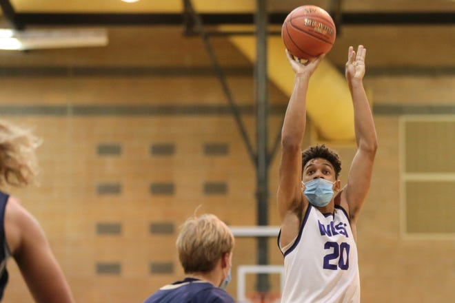 Topeka West senior Trevion Alexander throws up a 3 in the first half of Saturday's game against Hayden during the Topeka Invitational Tournament at Topeka High.