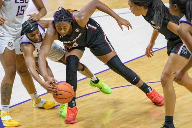 South Carolina's Aliyah Boston (4) battles for the ball with LSU's Rakell Spencer on Sunday at Baton Rouge, Louisiana.