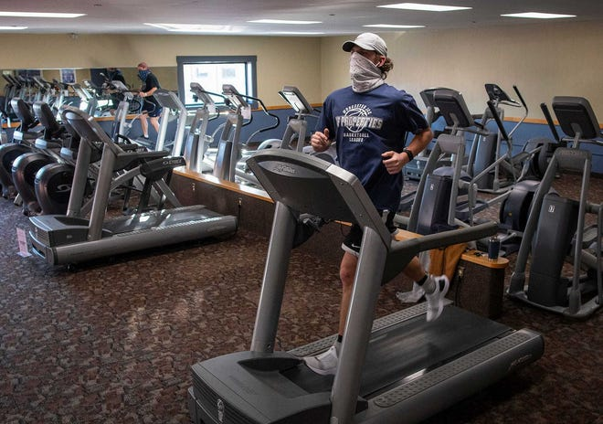 Connor Brown of Worcester runs on a treadmill in Worcester Fitness late last month.