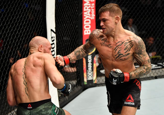 Dustin Poirier punches Conor McGregor during Saturday's fight.