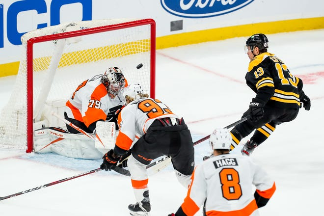 Bruins center Charlie Coyle (13) scores during the second period past Flyers goalie Carter Hart during Boston's 6-1 victory Saturday night at TD Garden.