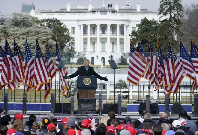 FILE - In this Jan. 6, 2021, file photo with the White House in the background, President Donald Trump speaks at a rally in Washington. (AP Photo/Jacquelyn Martin, File)