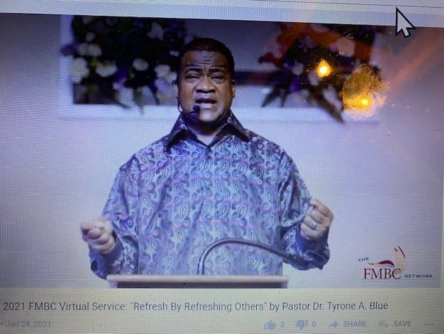 Dr. Tyrone A. Blue, senior pastor of First Missionary Baptist Church, delivers the sermon during the church's morning worship service via YouTube.