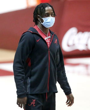 Alabama football signee Kool Aid McKinstry is seen with the Alabama basketball team in Coleman Coliseum before the game with Mississippi State Saturday, Jan. 23, 2021. [Staff Photo/Gary Cosby Jr.]