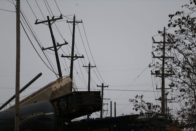 Seven cars derailed on top of the CSX Railroad bridge overtop on Gest Street in Queensgate Sunday morning. Duke Energy has also responded to the scene.