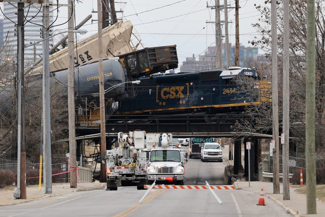Seven cars derailed on top of the CSX Railroad bridge overtop on Gest Street in Queensgate Sunday morning.