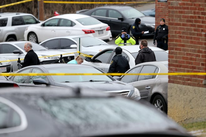 Cincinnati police investigate a homicide in the 1700 block of Grand Avenue in the East Price Hill neighborhood of Cincinnati, Sunday, Jan. 24, 2021.