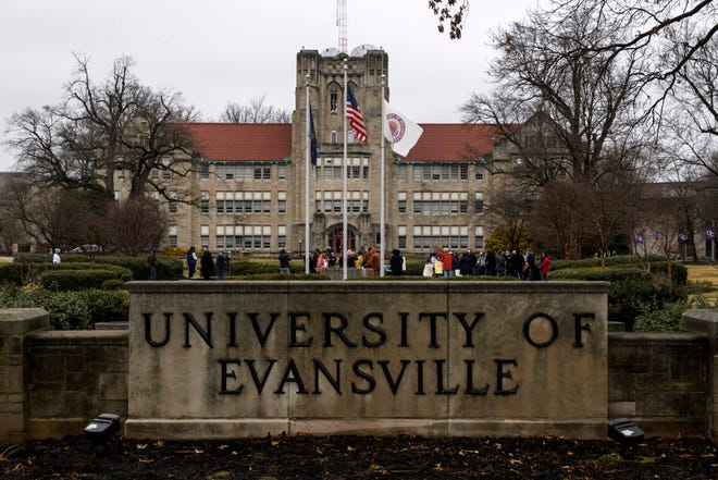People gather at Clifford Circle on the front lawn of the University of Evansville campus before lining up along the sidewalks of Lincoln and Weinbach Avenues to protest the university's realignment plan in Evansville, Ind., Sunday afternoon, Jan. 24, 2021. If the plan is carried through with, it would cut a quarter of the University's faculty, eliminate three departments and 17 majors.
