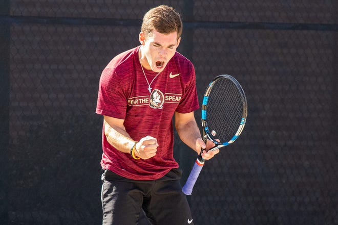 Chase Wood celebrates winning a point at the Scott Speicher Memorial Tennis Center in Tallahassee, FL.
