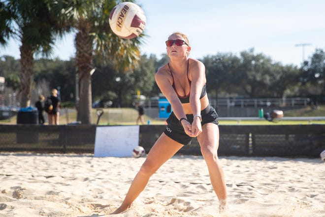 Maddie Anderson (pictured) prepares to hit the volleyball during a practice at the FSU Sand Volleyball Courts in Tallahassee, FL., on Jan. 20, 2021.