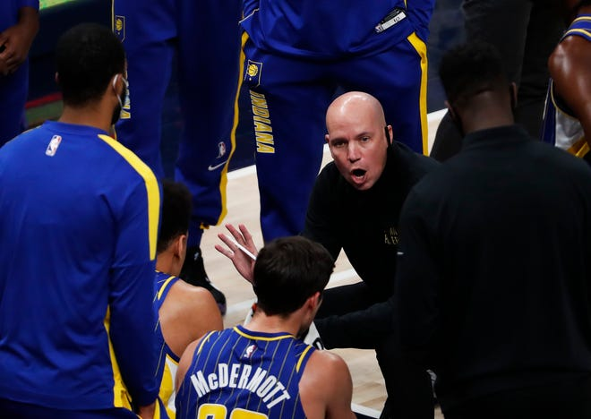 Indiana Pacers head coach Nate Bjorkgren talks with players during a time out in the first half against Toronto Raptors on Sunday, Jan. 24, 2021 at Bankers Life Fieldhouse. Toronto Raptors lead after the first half, (47-58).