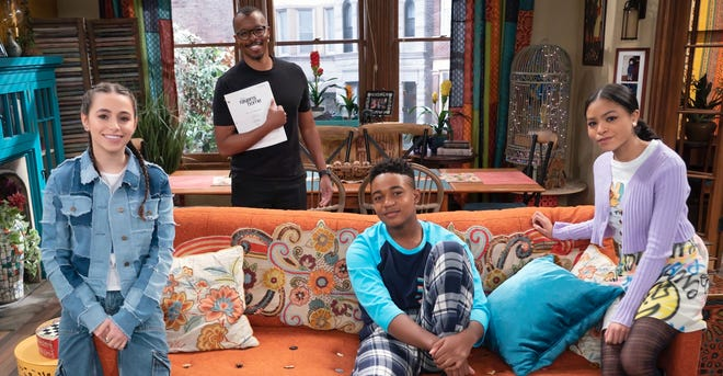 """Darnell Jones on the set of """"Raven's Home"""" with cast members Sky Katz, Issac Ryan Brown and Navia Robinson. He's holding the script he wrote for the series that will air sometime this year."""