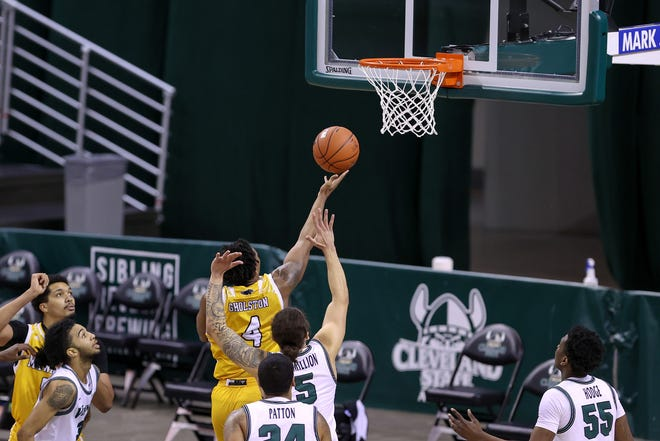 Guard DeAndre Gholston scores the winning basket in overtime Saturday against Cleveland State at the Wolstein Center.