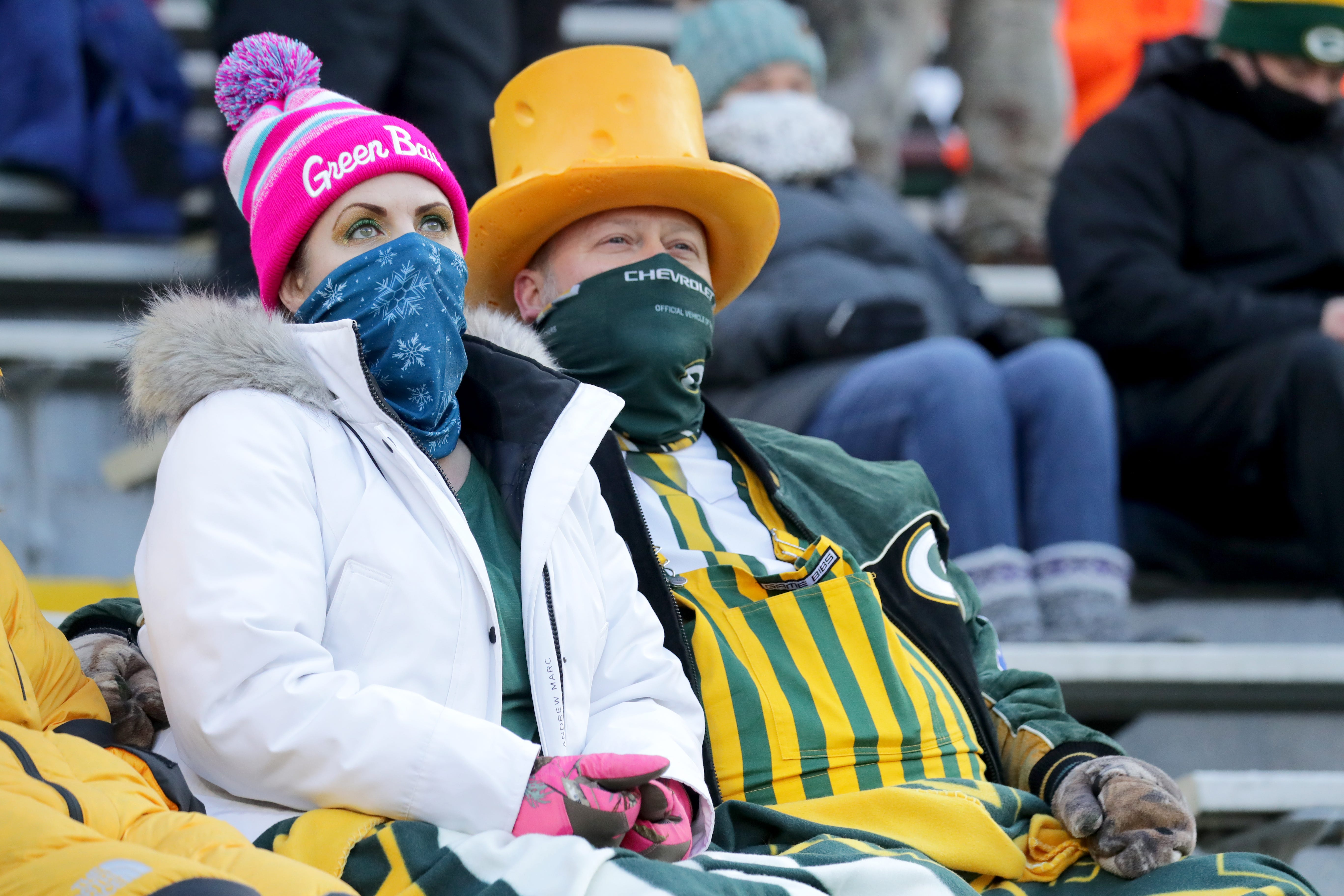 Fans watch, dejected, during the fourth quarter of the Green Bay Packers game against the Tampa Bay Buccaneers for the NFC championship at Lambeau Field in Green Bay on Jan. 24, 2021.