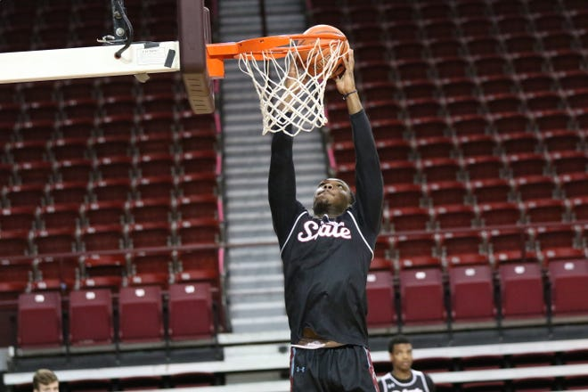 Redshirt freshman guard Marcus Watson goes up for a dunk during New Mexico State's practice at the Pan American Center on Jan. 23, 2021.