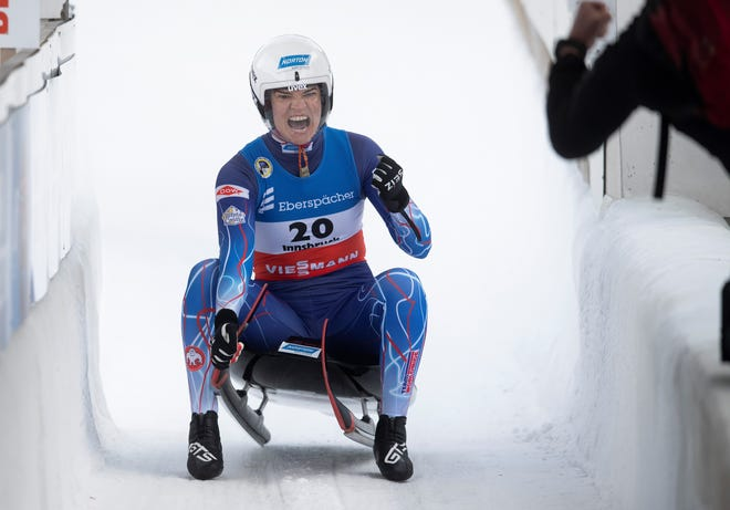 Summer Britcher of the United State celebrates after her 2nd run during a women's race at the Luge World Cup event in Innsbruck, Austria, Sunday, Jan. 24, 2021. (AP Photo/Andreas Schaad)