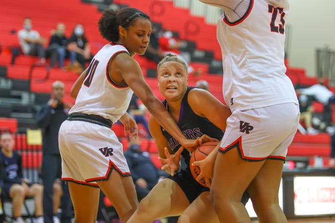 JaKayla Thomspon of Cedar Ridge gets surrounded in the lane while trying to score against Vista Ridge in the first District 26-5A battle between the teams Jan. 5 at Vista Ridge High School. Vista Ridge held on to win 50-48 and claim first place in the district race. The two teams meet against Friday.