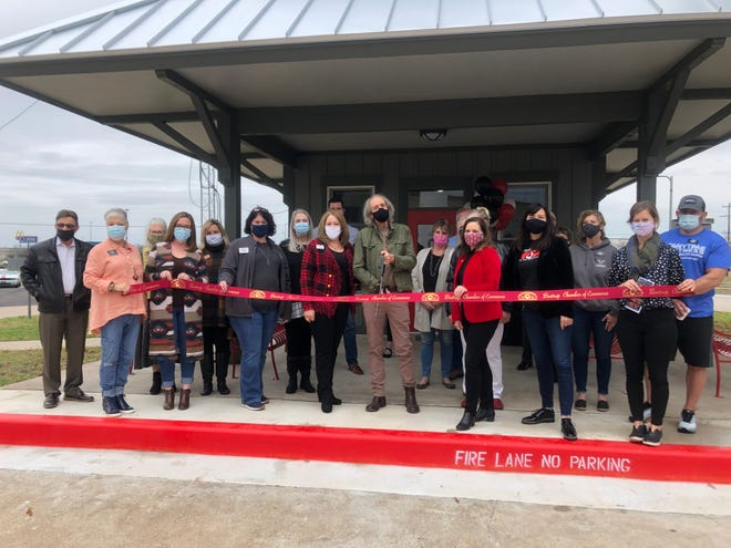 Bastrop city officials, local business leaders from the Bastrop Chamber of Commerce and CARTS representatives pose for a photo Jan. 21 during a ribbon-cutting ceremony at the renovated CARTS Bastrop station. The station is located at 310 Hospital Drive.