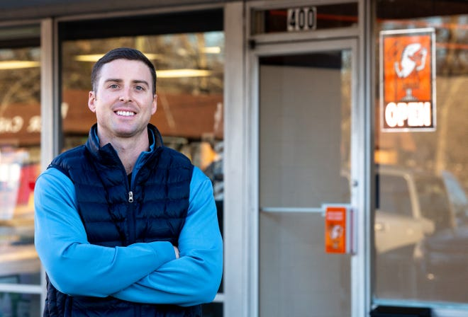 Brendan Douglas, 26, former UGA running back and new owner and operator of the Little Caesars franchise at 1063 Baxter Street, poses for a portrait in front of the restaurant in Athens, Ga., on Monday, Jan. 18, 2021. (Casey Sykes for The Athens Banner-Herald)