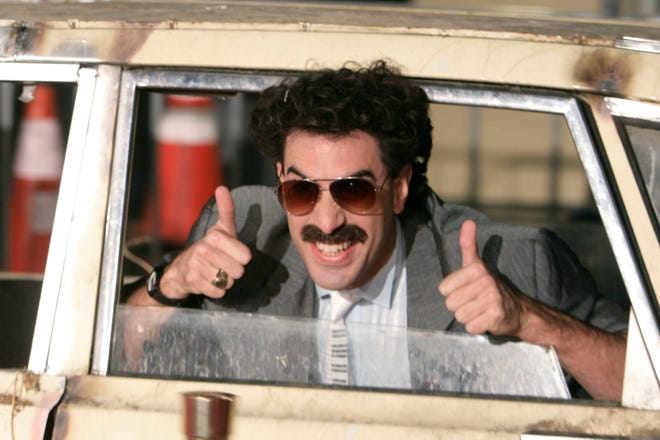 """In this Monday, Oct. 23, 2006 file photo, actor Sacha Baron Cohen arrives in character as Borat for the film premiere of """"Borat: Cultural Learnings of America for Make Benefit Glorious Nation of Kazakhstan,"""" in the Hollywood section of Los Angeles."""