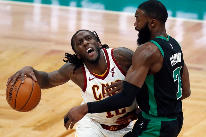 Boston Celtics' Jaylen Brown (7) defends against Cavaliers' Taurean Prince (12) during the first half of an NBA basketball game, Sunday, Jan. 24, 2021, in Boston. [Michael Dwyer/Associated Press]