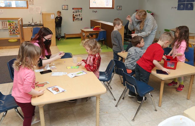 Teachers Jordan Philpot, left, and Kayla Bell work with the preschool and pre-k class Monday at Here For You Child Development Center in Canal Fulton. The CEO of Here for You Child Development Center would like to see child care workers become part of the COVID-19 vaccine rollout.