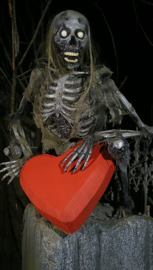 A skeleton holds onto a heart for past edition of A Valentine's Haunted House at the Haunted Schoolhouse. The haunt is not opening this Valentine's Day because of COVID-19 concerns.