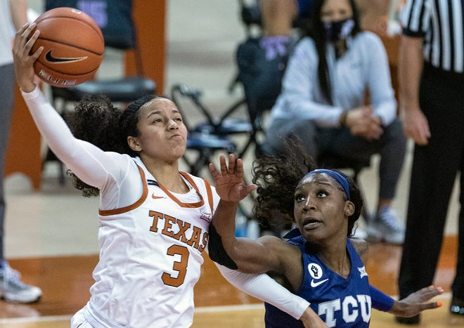 Texas guard Karisma Ortiz (3) gets a shot off against TCU's Aahliyah Jackson during a game at the Erwin Center on Jan. 20, 2021.