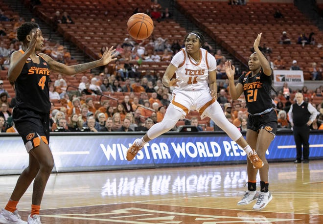 UT guard Joanne Allen-Taylor passes the ball around Oklahoma State forward Natasha Mack at the Erwin Center on March 8, 2020.