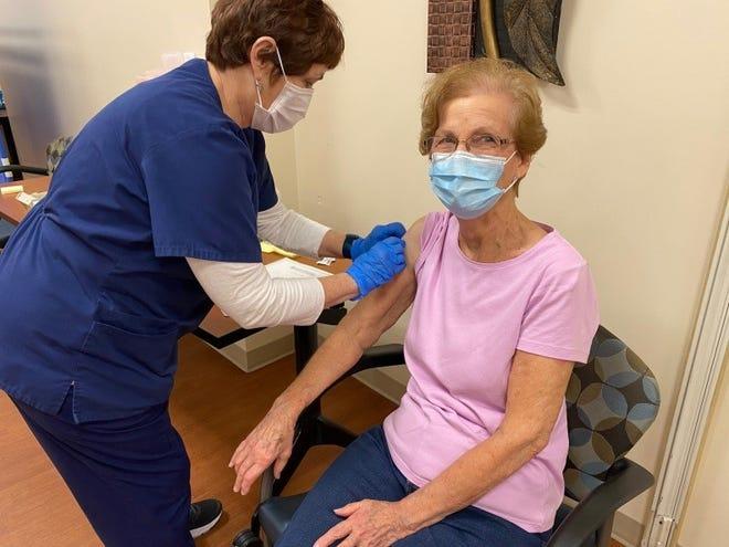 Kathryn Duncan of Salem, right, receives her COVID-19 vaccine on Jan. 22 from Salem Regional Medical Center nurse Karen Campf.
