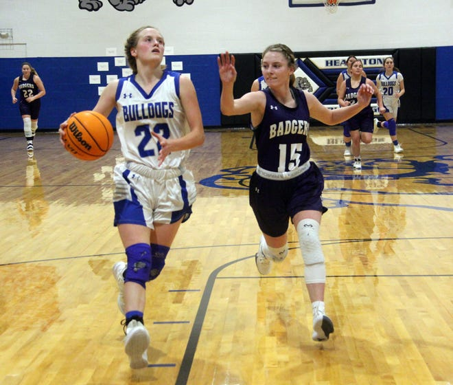 Healdton's Macey Howell drives to the basket on Saturday against Elmore City-Pernell. The senior tallied a game-high 22 points to help lead the Lady Bulldogs to a 55-42 win in the championship game.