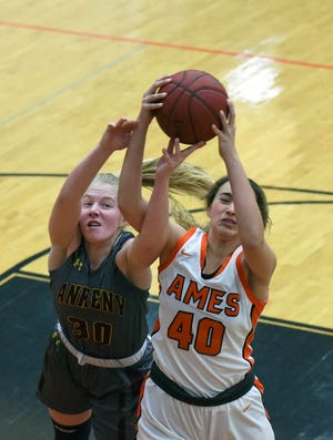 Ames' Kennedy White fights Ankeny's Abigail Johnson for a rebound during the first half of the Little Cyclones' 66-55 loss to the No. 13 Hawks Saturday in Ames. White came up huge in defeat, scoring 17 points on 7 of 7 shooting from the field and adding six rebounds.