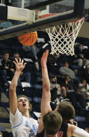 Bartlesville High forward Nick Smith attacks the side of the rim during varsity boys basketball action last week.