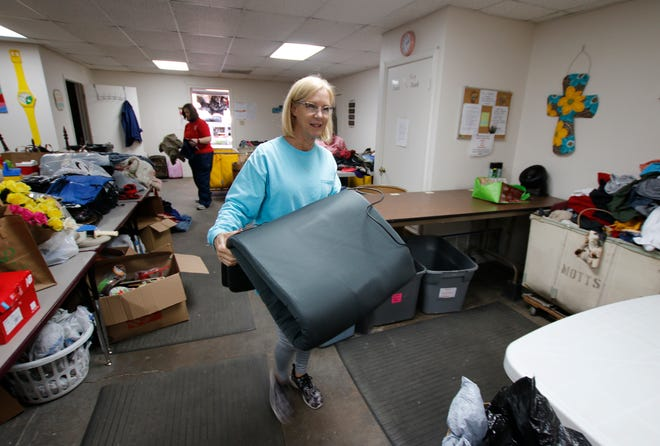 Melanie Haynes, a staff member at Good Samaritan Ministries' Donation Center, helps sort an organize items Monday afternoon inside the center, located at 200 W. Chandler in Brownwood. The center is observing its one-year anniversary.