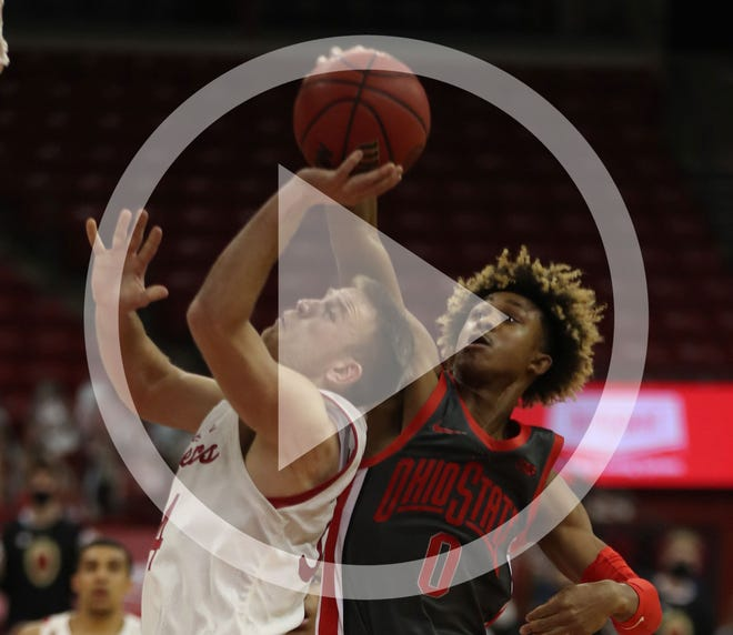 In this file photo, Ohio State Buckeyes guard Meechie Johnson Jr. blocks a shot by Wisconsin guard Brad Davison Saturday afternoon.