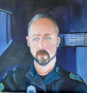 """This portrait of Jared, a police officer, is one of 25 oil paintings in Patty Hopkins Barnes' series """"Cape Cod Pandemic Heroes"""" on display at the Cultural Center of Cape Cod in South Yarmouth."""