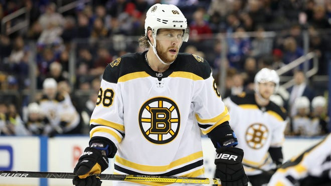 Bruins forward David Pastrnak expects to return to game action Saturday.