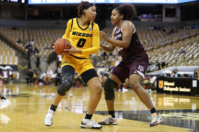 Missouri forward LaDazhia Williams (0) works against Texas A&M during a game Sunday at Mizzou Arena. Williams finished with 20 points.