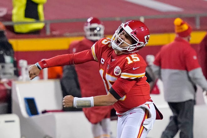 Kansas City Chiefs quarterback Patrick Mahomes celebrates after throwing a 5-yard touchdown pass to tight end Travis Kelce during the second half of the AFC championship game against the Buffalo Bills on Sunday night in Kansas City.