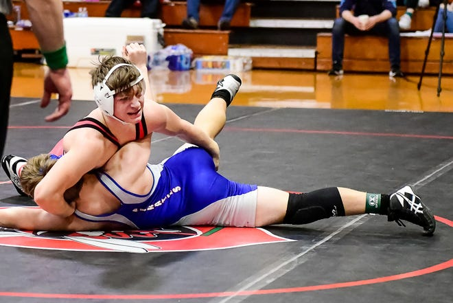 Freshman Brody Cairns of the 2020-21 Chillicothe High School wrestling Hornets tries to turn a Boonville opponent turned to his back during the Jan.16 CHS Invitational Tournament. Last Saturday (Jan. 23), he won the Midland Empire Conference Championships 160-pounds title.
