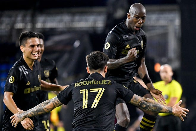 Bradley Wright-Phillips, right, believes he is in the midst of a late-career rebirth, and also sees the Crew as the best fit in his quest to win an MLS Cup championship. He scored eight goals last season for Los Angeles FC.