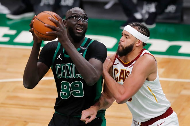 Boston Celtics center Tacko Fall (99) looks to shoot over Cavaliers center JaVale McGee during the Celtics' 141-103 win Sunday night in Boston. [Associated Press]