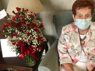 Helen Gregg sits with just some of the 105 flowers she received for her 105th birthday on Jan. 22. The flowers were sent to her by the Stop Nine Church of Christ in Byesville.