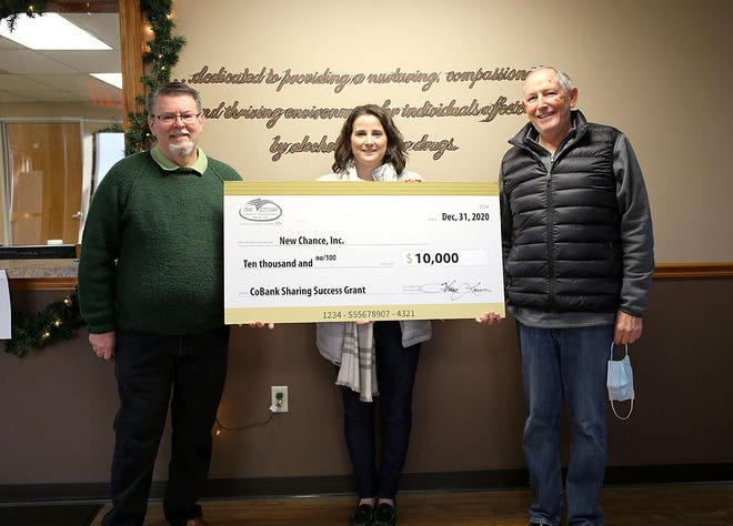 Victory Electric vice president of communications Jerri Imgarten-Whitley gives a $10,000 grant to New Chance Inc. in Dodge City to go toward expanding services and security.