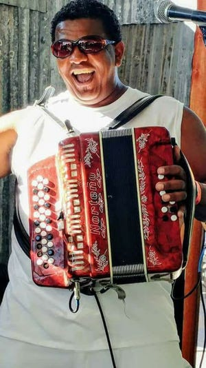 Music is straight from Louisiana by Dikki du & the Zydeco Krewe at AJ's Mardi Gras Brunch.